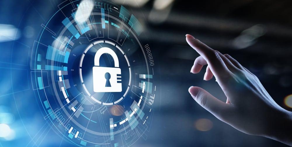 Cybersecurity hand touching digital lock